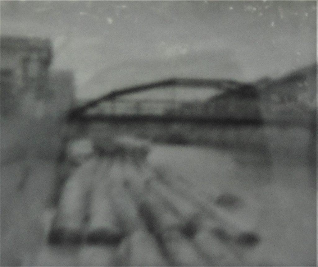 江東区の案内板に掲示されているかつての八幡堀の写真画像。